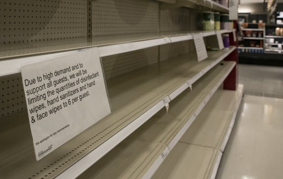 Empty shelves of cleaning supplies are accompanied by a sign limiting quantities. Inventory has plummeted as demand increases amid the coronavirus outbreak.