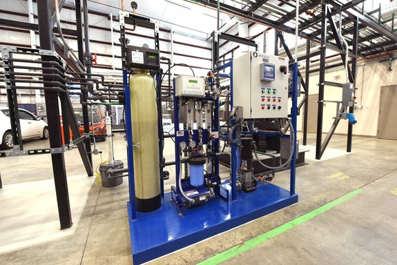 Water purification system used with the High Temperature Electrolysis unit to make steam and then hydrogen inside of a warehouse.