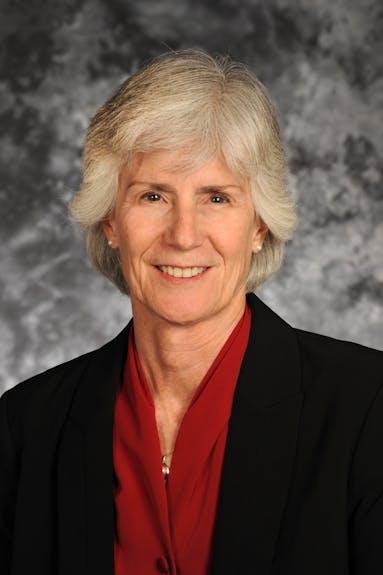 A portrait of Dr. Marianne Walck against a grey studio background.